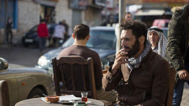 Brown leather jacket worn by Aviram Dahan (Tomer Sisley) as seen in Messiah Season 1