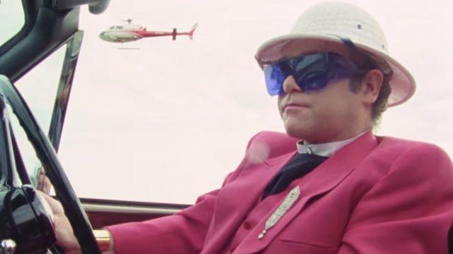 Blue sunglasses worn by Elton John as seen in I'm Still Standing