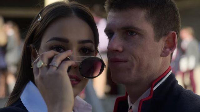 Les lunettes de soleil portées par Lu Montesinos (Danna Paola) dans la série Élite (Saison 2 Épisode 1)