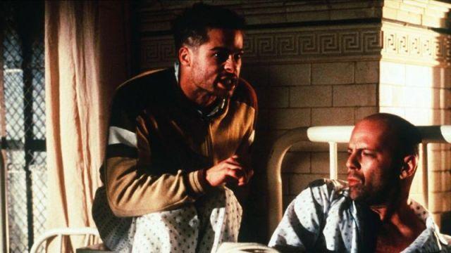 Tan track with dark brown and white elements,zipper jacket of Jeffrey Goines (Brad Pitt) in Twelve Monkeys
