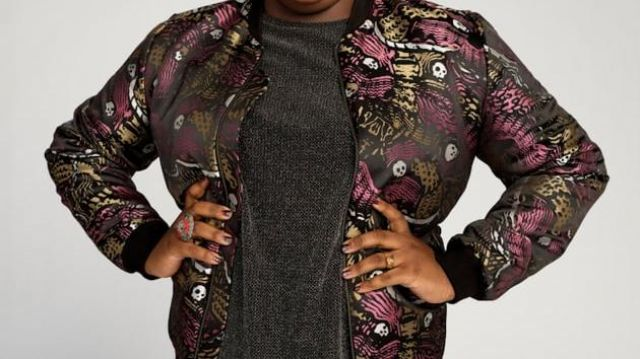 Black, gold, and purple skull jacket worn by Mo (Alex Newell) in Zoey's Extraordinary Playlist (S01E01)