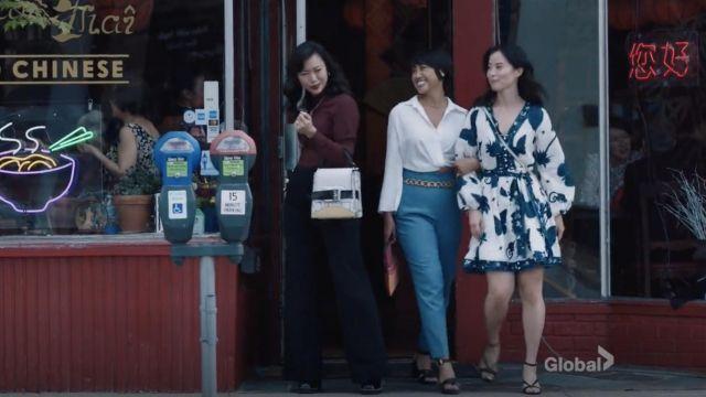 Butterfly print wrap dress worn by an actress as seen in FBI: Most Wanted wardrobe (Season 3 Episode 4)